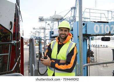 Docker dude in hardhat, smiling to camera