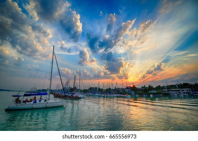 Docking sailboat in the harbor on a summer evening in the sunset