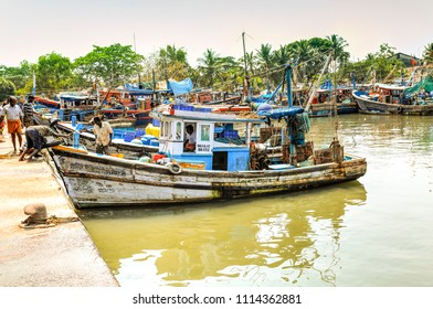 Fisherman's docking their colorful boats in the Kannur, Kerala, India, fishing market to sell their today catch. Photo taken on   27 April 2018.