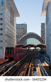 A Docklands Light Rail train passing through Canary Wharf in London