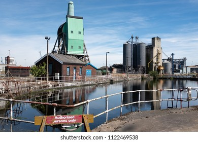 Docks with danger sign, silos, Tom Pudding loader and old mill