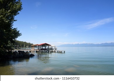 Docks on Flathead Lake, Montana, under a clear blue sky