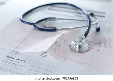docter workplace with a stethoscope Cardiogram chart with medical table closeup,for heart record
