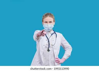 The doctor addresses the viewer. This concerns you! Woman doctor points her finger at you. Hey, you! Health professional warning.