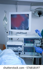 Doctor adjusting special equipment in operating room