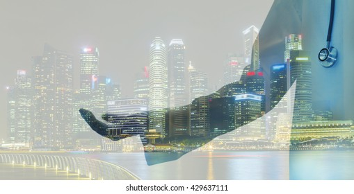 Doctor advertising your product and double exposure of business with blur city night.