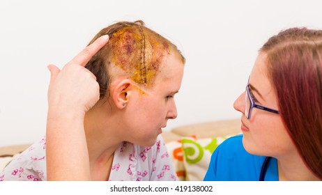 Doctor after neurosurgery of brain edema investigating her head's suture.