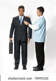 Doctor analizing an android businessman.