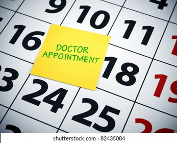 Doctor appointment written on a sticky note on a calendar.