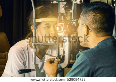 714d7d66f78 Doctor and Asian young woman looking at eye test machine in  ophthalmologist. ophthalmologist. medical