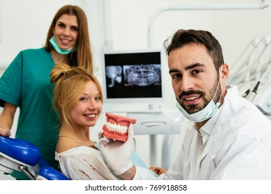 doctor and the assistant during a surgery - Stock image