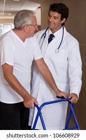 A doctor assisting a senior citizen onto his walker.