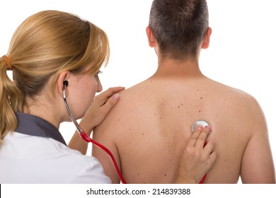 A doctor auscultates a male patient from behind
