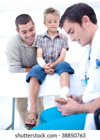 Doctor bandaging a child's foot in hospital