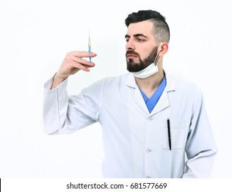 Doctor with beard holds syringe.