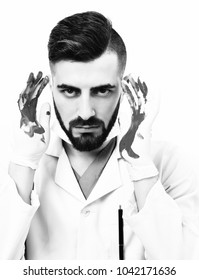 Doctor with beard and mad face expression holds his bloody hands up, isolated on white background