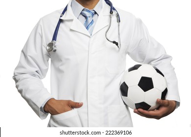 Doctor with black and white soccer ball isolated in white background