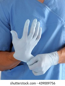 Doctor in blue uniform holding X-rays.