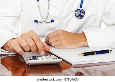 doctor with a calculator. calculation of costs and revenues in physician practice and hospital