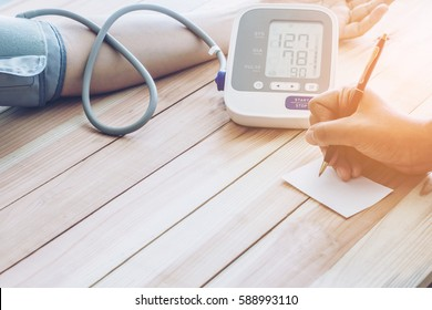 Doctor cardiologist measuring blood pressure of male patient. . Health concept
