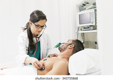 Doctor is caring a sick man in hospital
