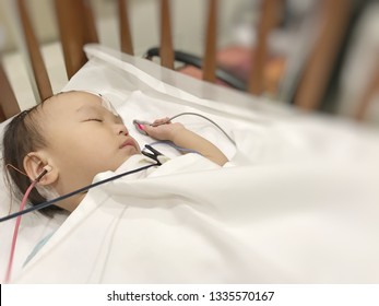 Doctor checking hearing loss in children. Auditory Brainstem Response.