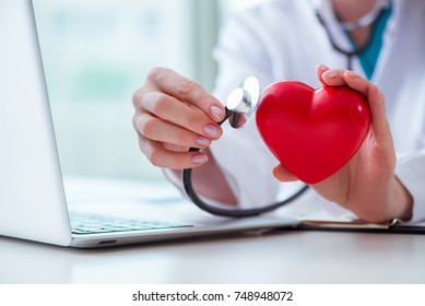 Doctor checking up heart in medical concept