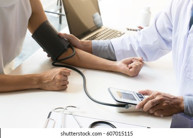 Doctor checking old woman patient arterial blood pressure. Health care.