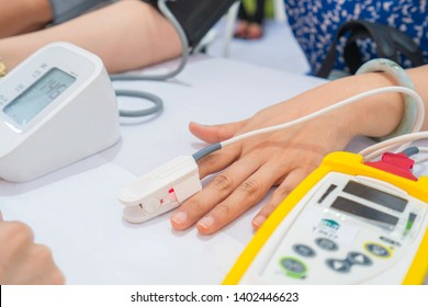 Doctor checking patient are measuring oxygen and heart rate in hospital. Health care Concept.