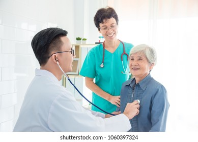 Doctor checking patient's heartbeat by stethoscope at hospital