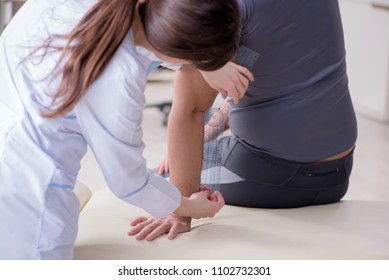 Doctor checking patients joint flexibility with gonimeter