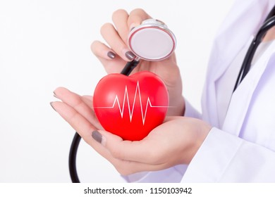 Doctor checking the red heart with ecg line and stethoscope. Isolated on white background. Studio lighting. Concept for healthy