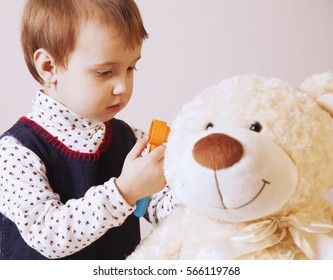 Doctor checking teddy bear patient's ear with otoscope (humorous photo)
