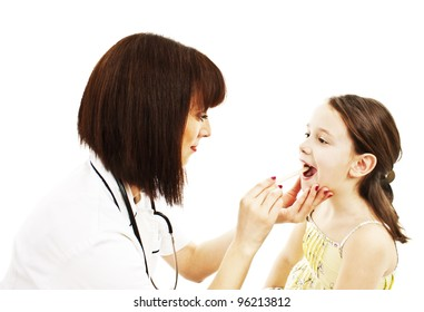 Doctor checking the throat of a young patient. Isolated on white background