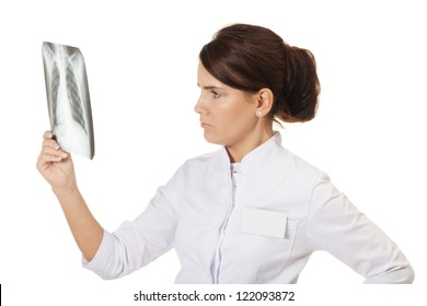 Doctor checking X-ray image on isolated white