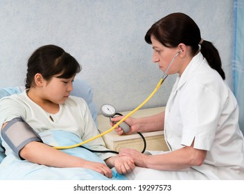 The doctor checks a blood pressure at the child