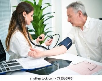 Doctor cheking a patients blood pressure