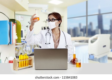 Doctor with chemicals working on laptop in a clinic