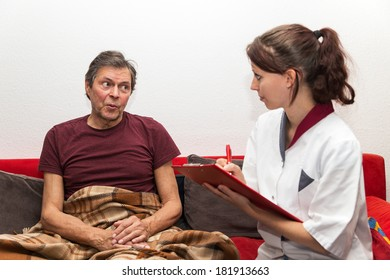 doctor with clipboard and senior adult