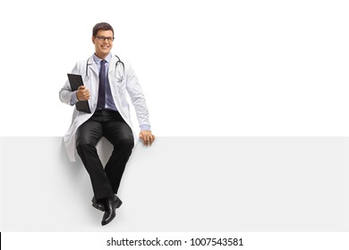 Doctor with a clipboard sitting on a panel isolated on white background