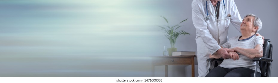 Doctor comforting an old patient; panoramic banner