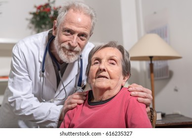 Doctor comforting senior woman