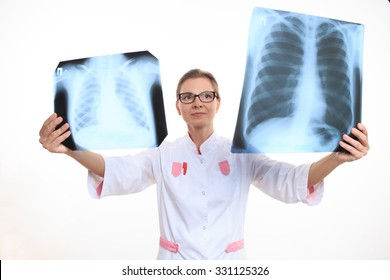 doctor compares the two X-ray.