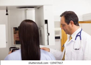 Doctor conducting a mammography on a patient  in an examination room