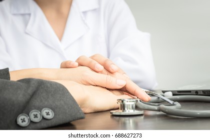 doctor consult patient in office