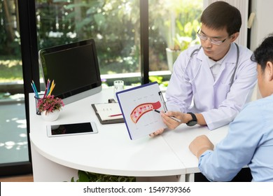 Doctor consultation Patient about  blood vessel with explain model of blood vessel on clipboard in medical office at hospital