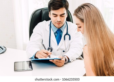 Doctor consulting and check up information with female patien on doctors table in hospital.healthcare and medicine