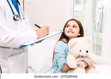 Doctor consulting and check up information with little girl in hospital.A little girl has sick.healthcare and medicine