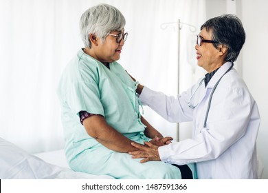 Doctor consulting and check up information with senior woman in hospital.elderly woman has sick.healthcare and medicine