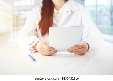 Doctor consulting with patient presenting results